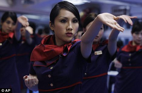On a wing chun and a prayer: These air stewardesses may look dainty, but they pack a big punch