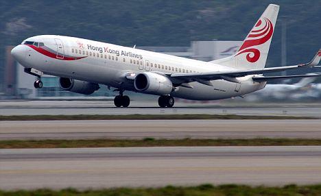 Wing-ing it: A Hong Kong Airlines plane touches down at Hong Kong International airport